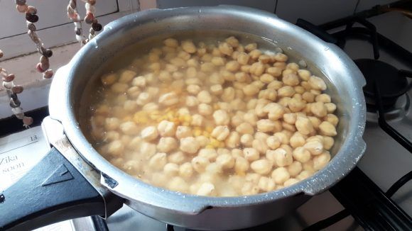 Boil soaked Kabuli chana and chana dal with salt, 1teaspoon of ginger paste