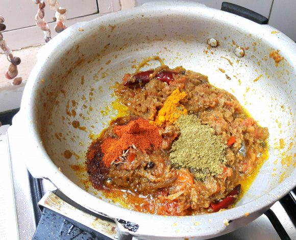 add chili powder, coriander powder, turmeric powder and salt