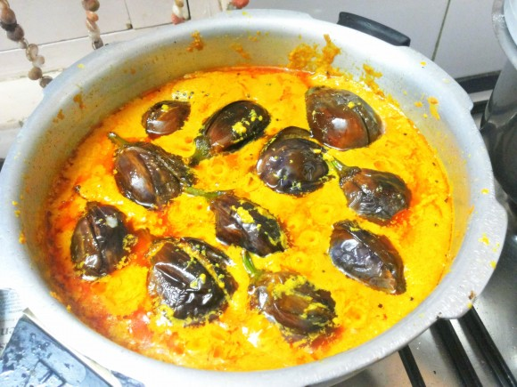 Add salt, fried brinjal and tomatoes