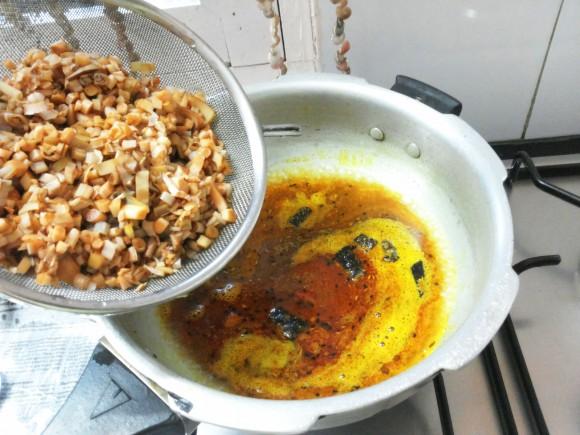 Add salt and boiled banana flower