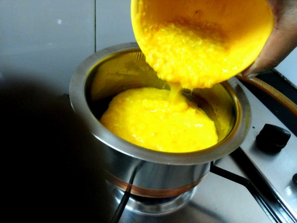 Adding  cooked dal
