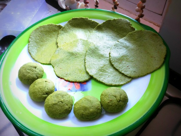 balls and raw Palak (spinach) poori