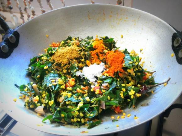 Add salt, red chili powder, coriander powder and turmeric powder