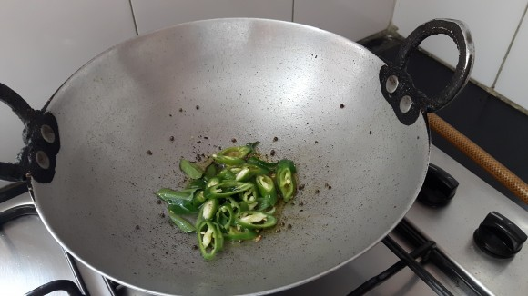 Add curry leaves, green chili