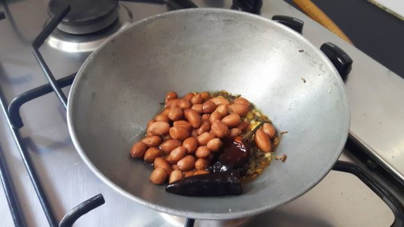 Add red chili and peanuts