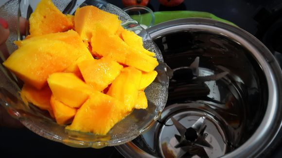 put chopped mango along with 100 ml milk and sugar