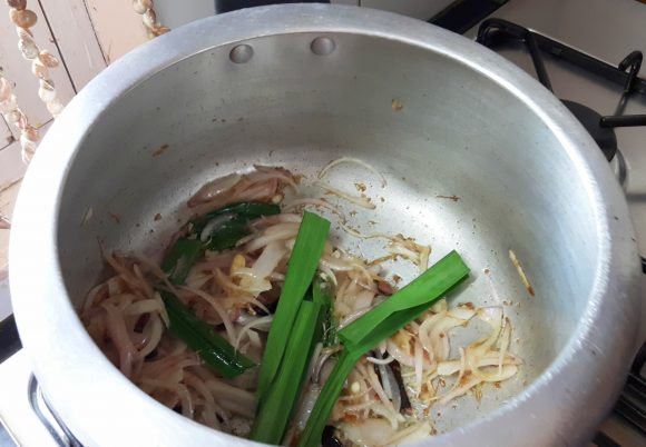 add sliced onion and ramba leaves