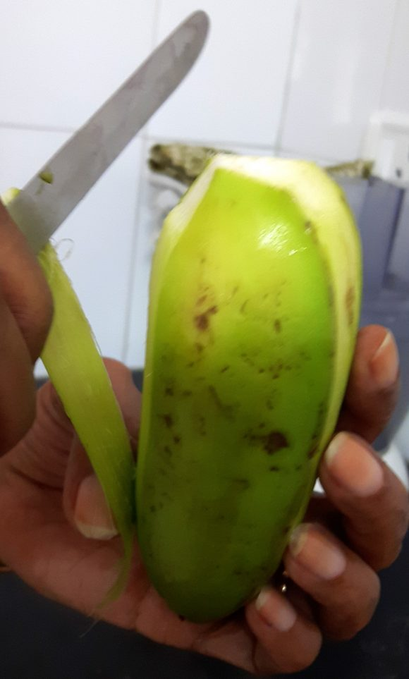 Discard the both ends and upper layer of raw banana