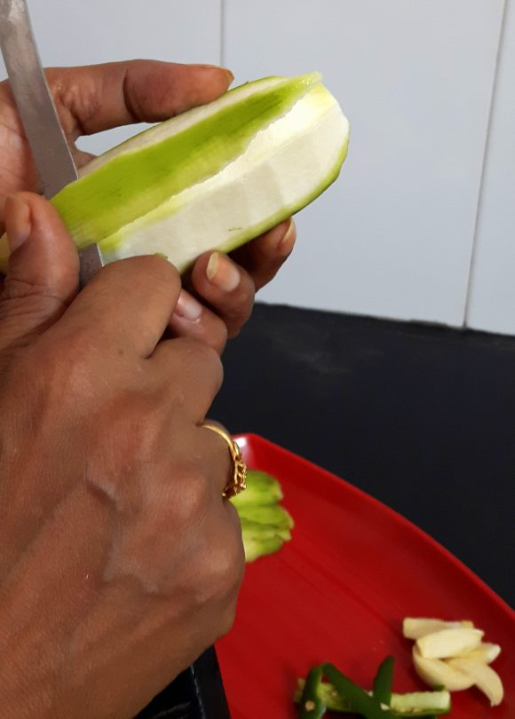 peel off the skin of raw banana thickly
