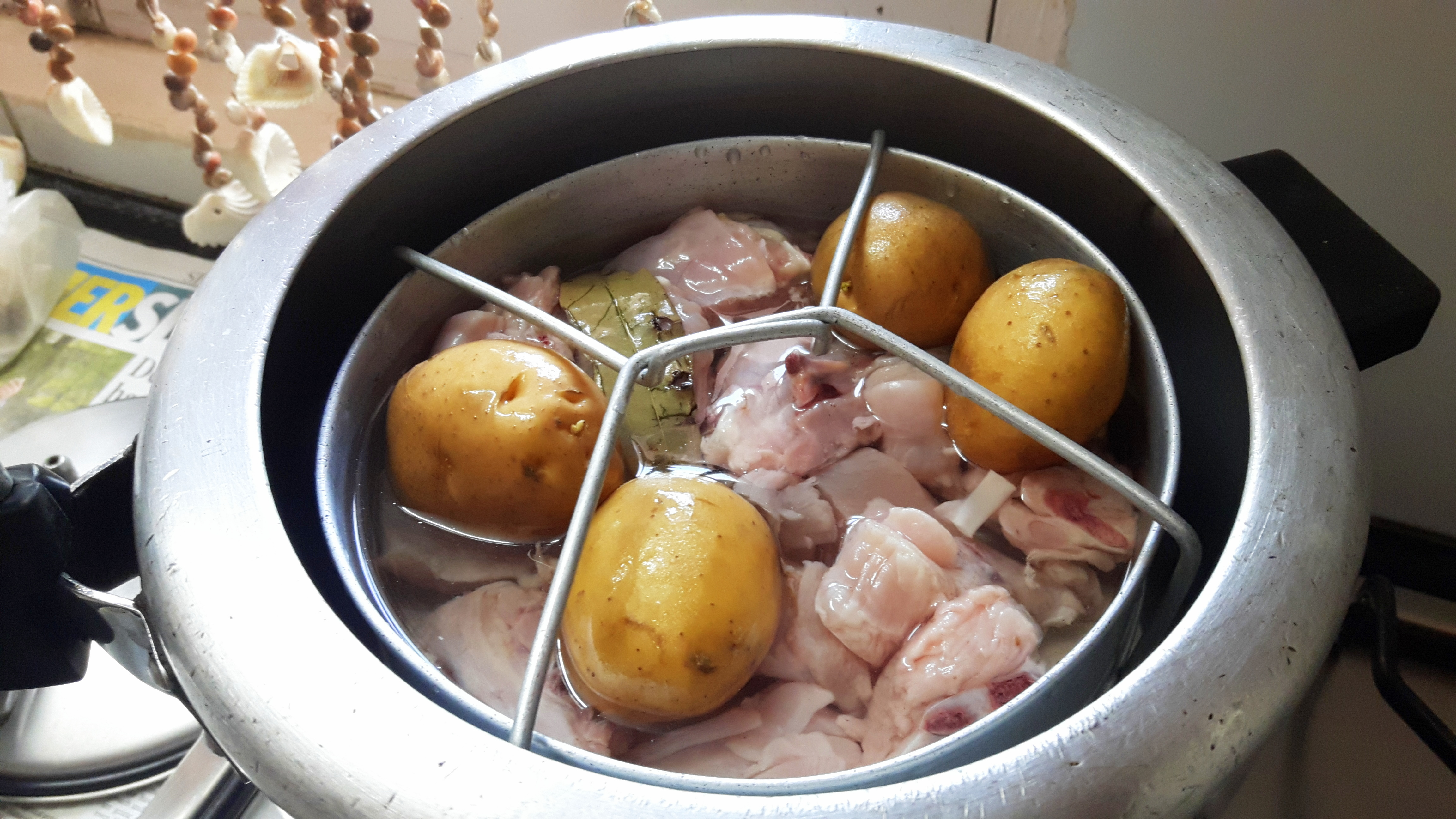 Boil the peeled potatoes with chicken