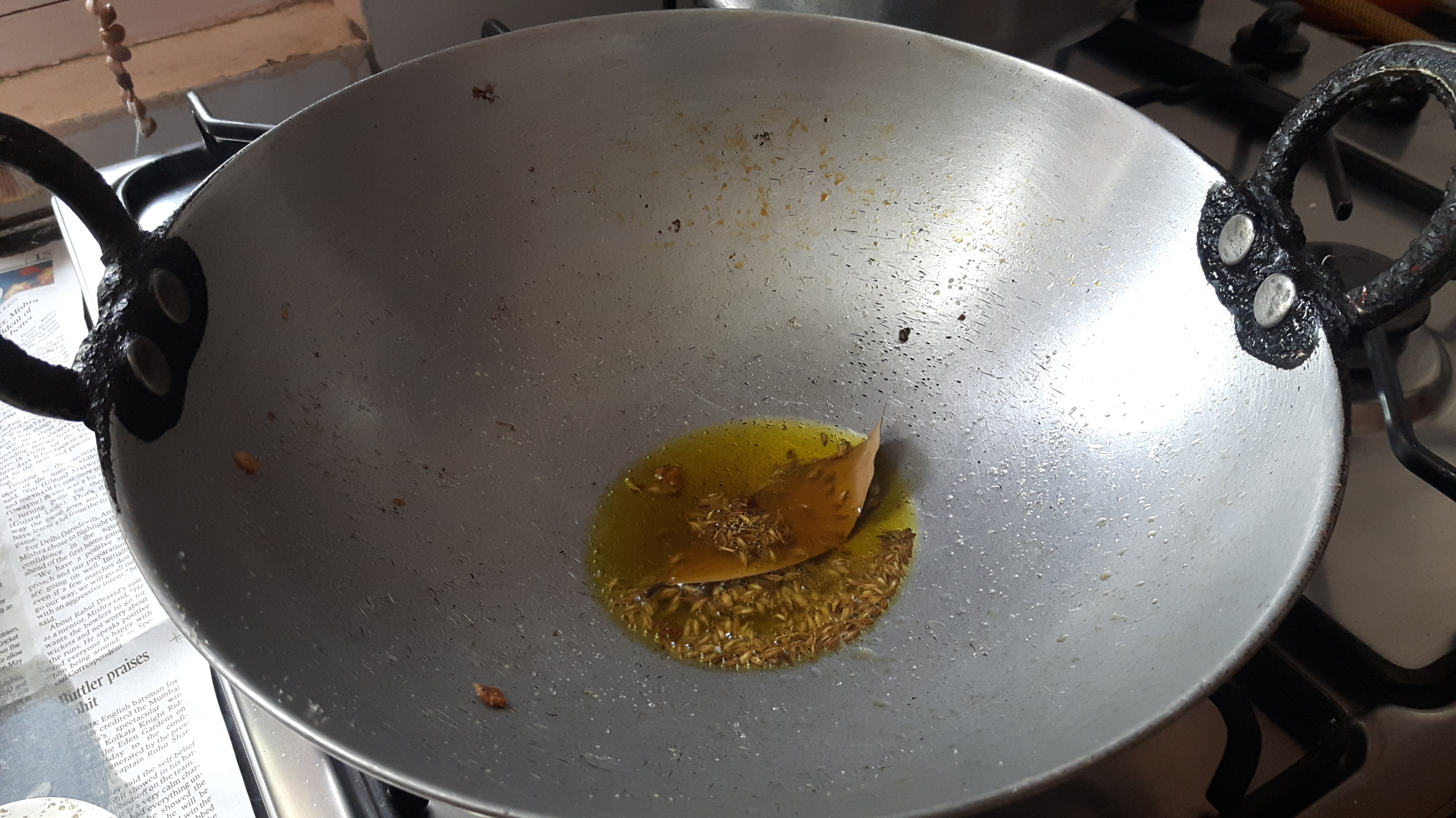 put 2 whole chilies, cumin seeds and bay leaf