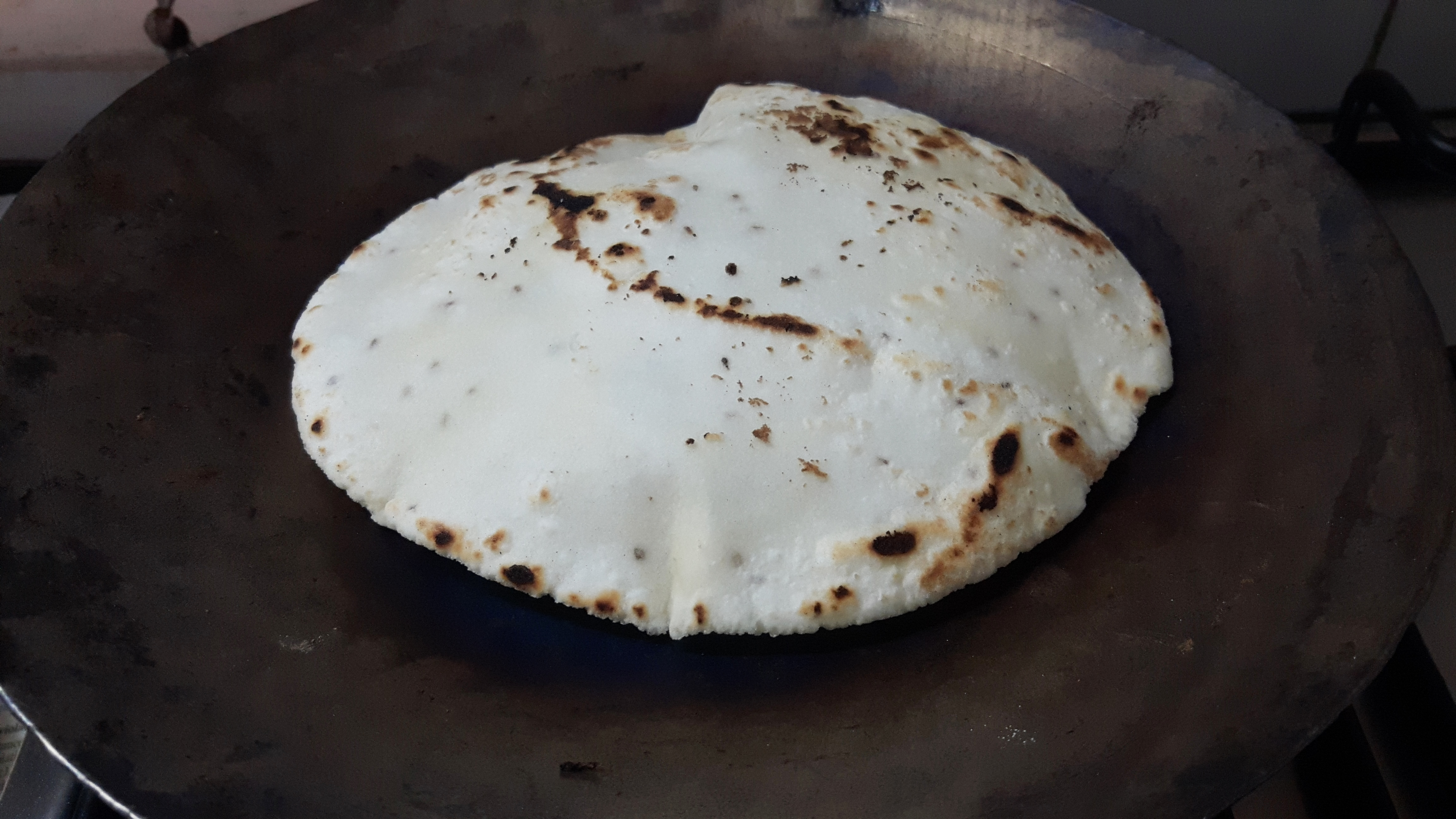 Now turn the side of roti on the tawa (use a handkerchief),