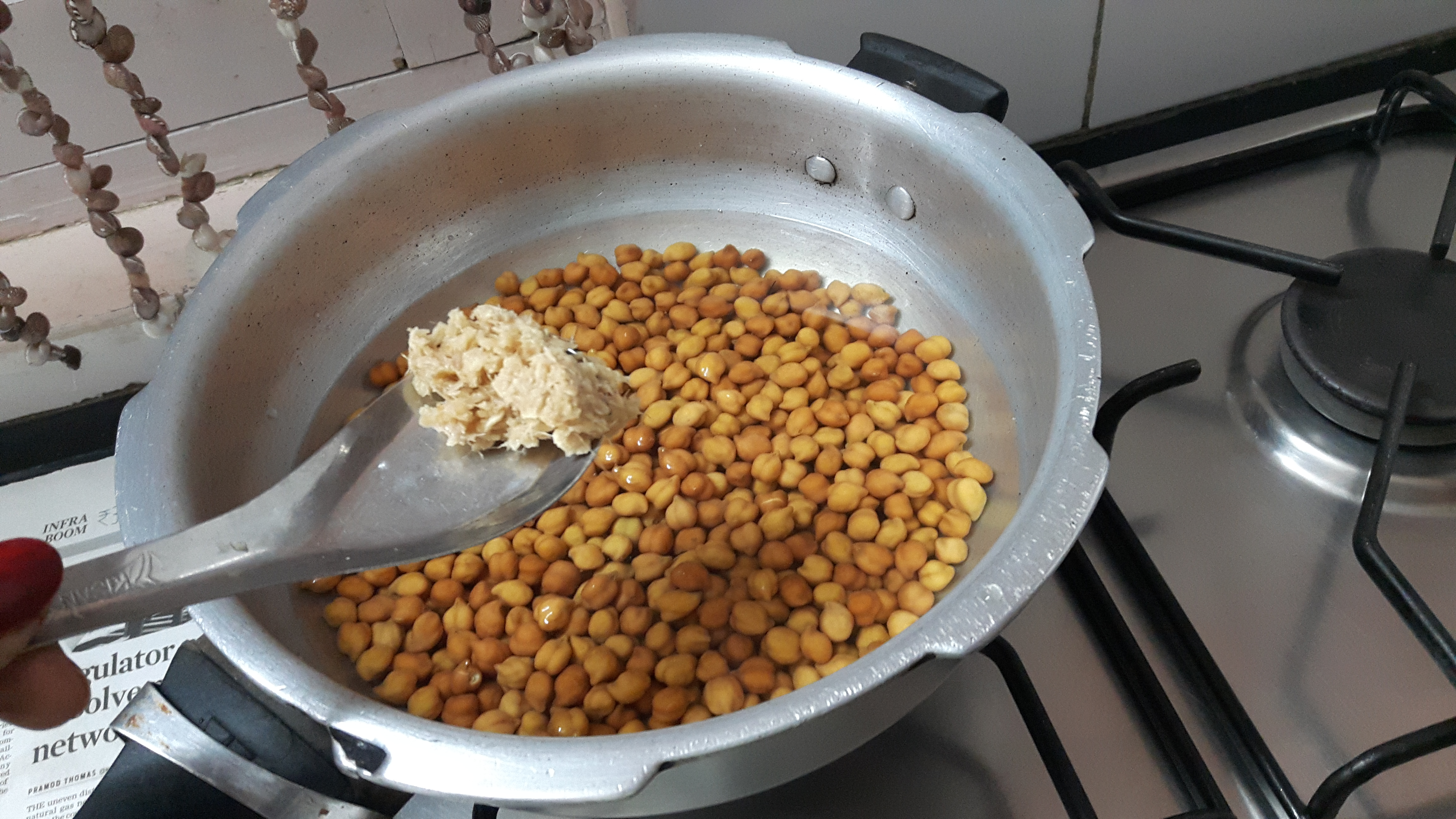 Cook kala chana along with salt and ginger paste