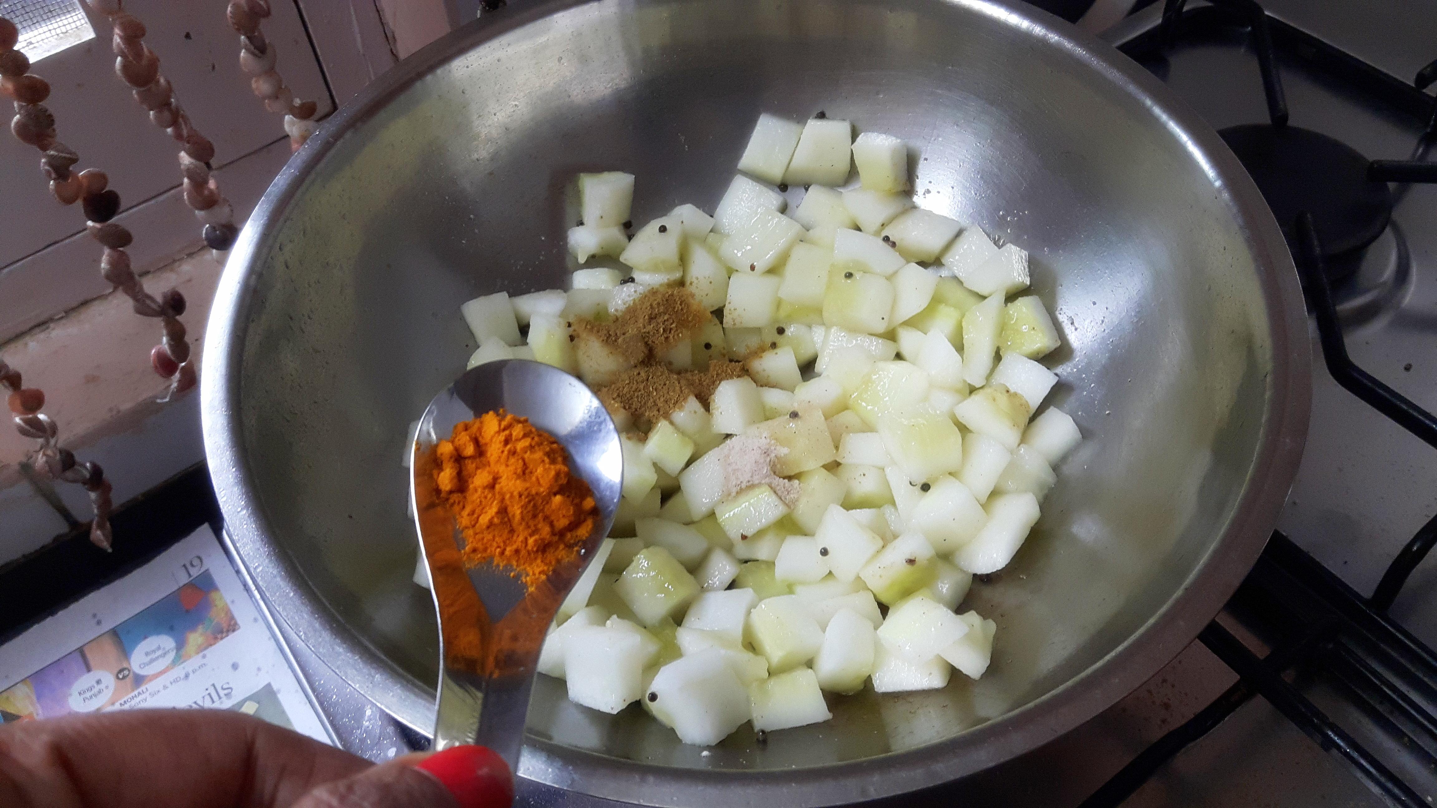 add salt, turmeric powder, chili powder