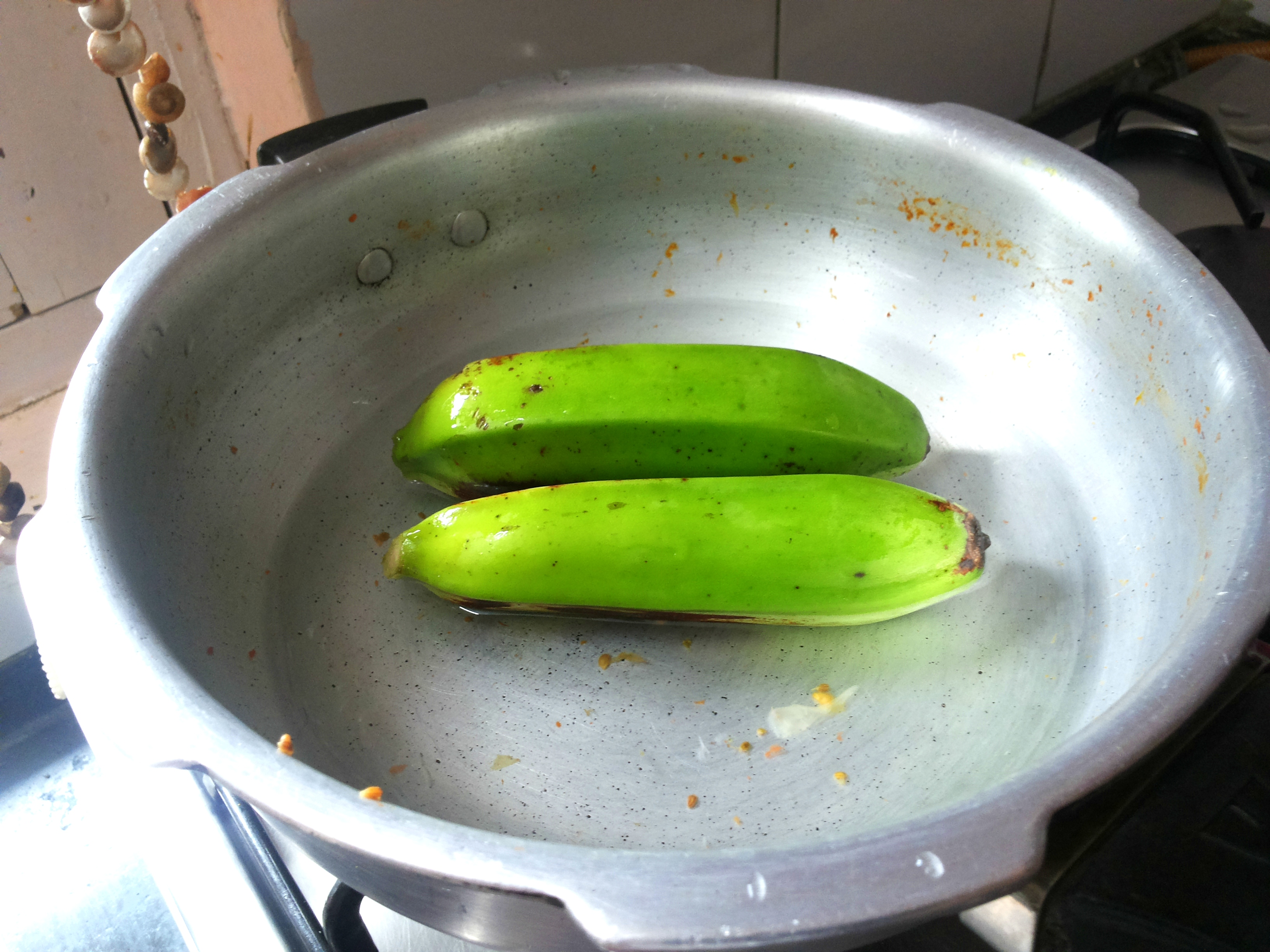 Boil/ microwave the raw banana