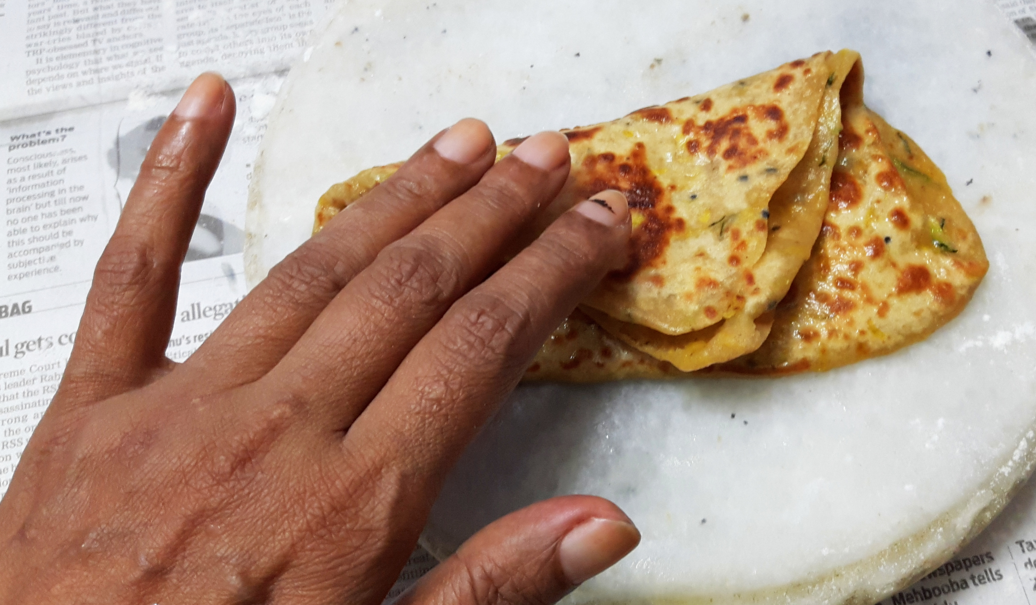 Clapping the paratha