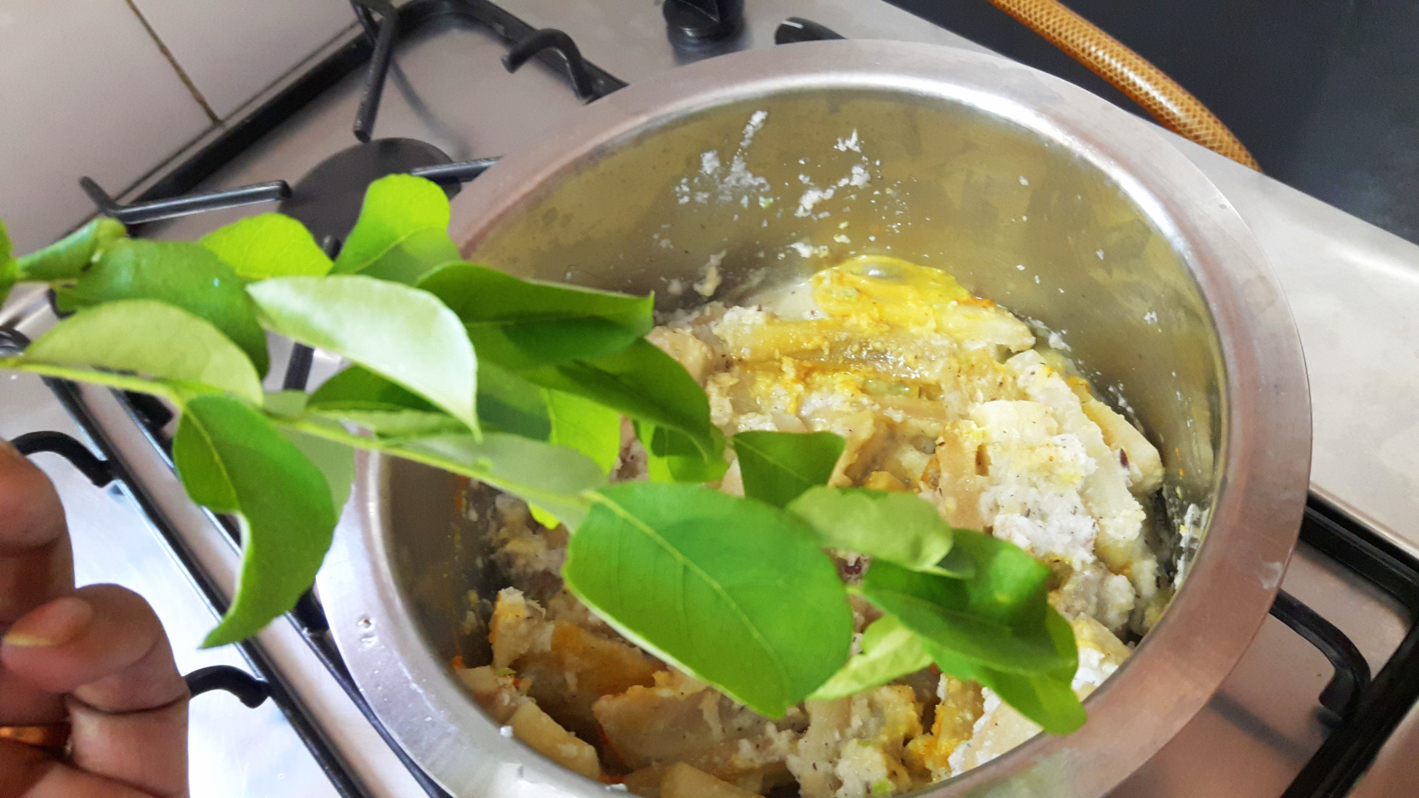 add prepared paste, curry leaves, turmeric powder
