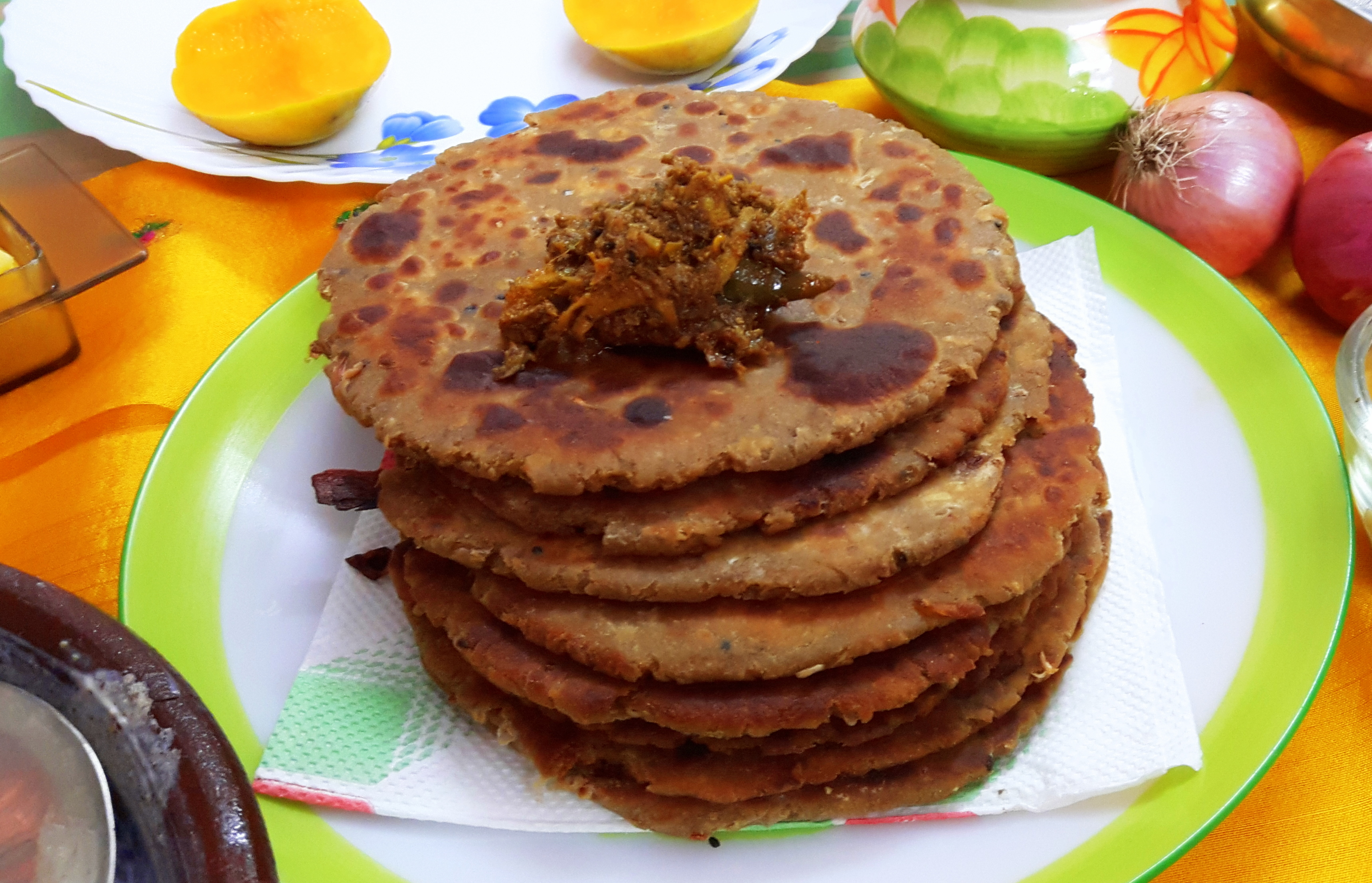 Sattu (fried gram flour) onion missi paratha