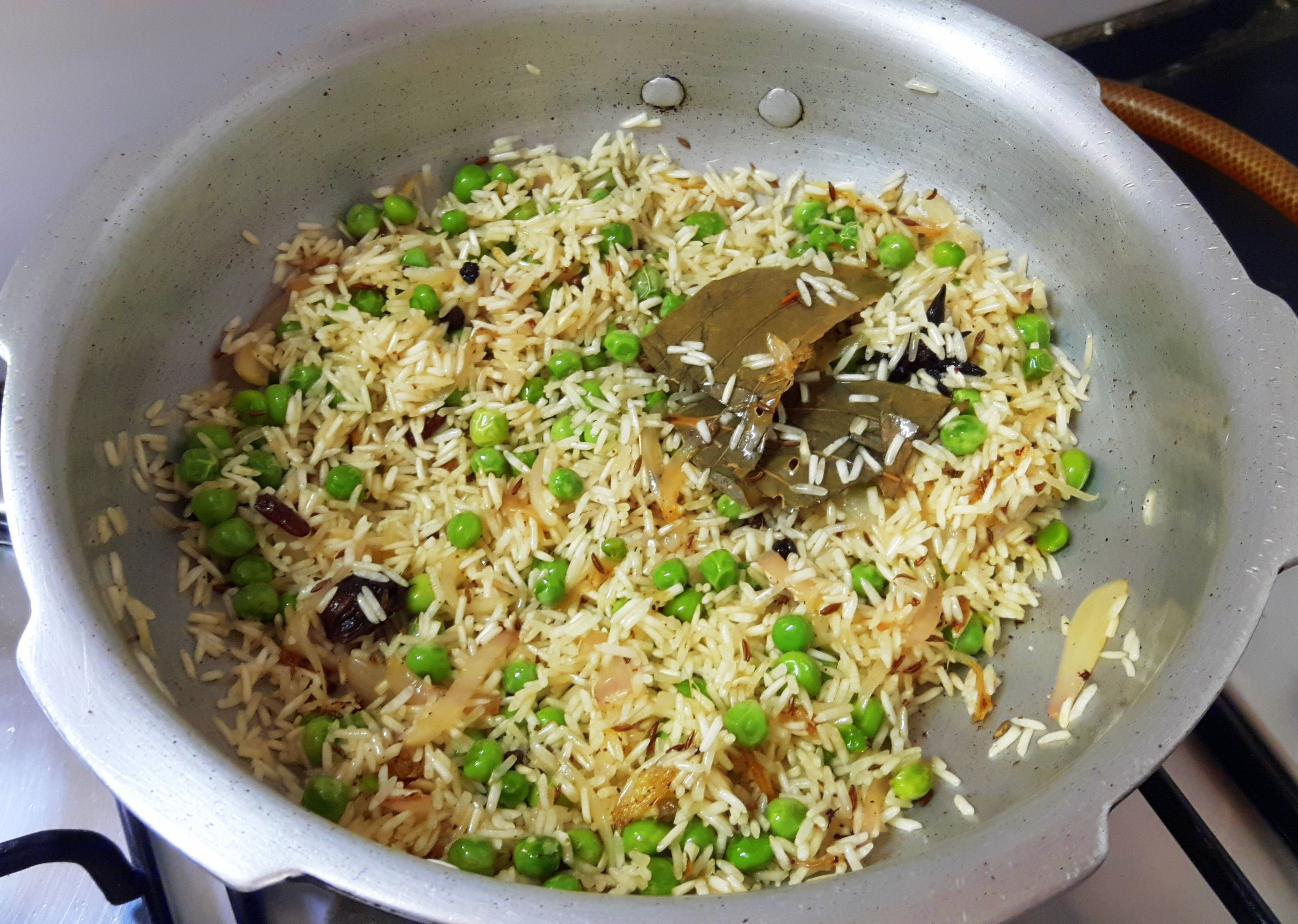 add washed rice and fry