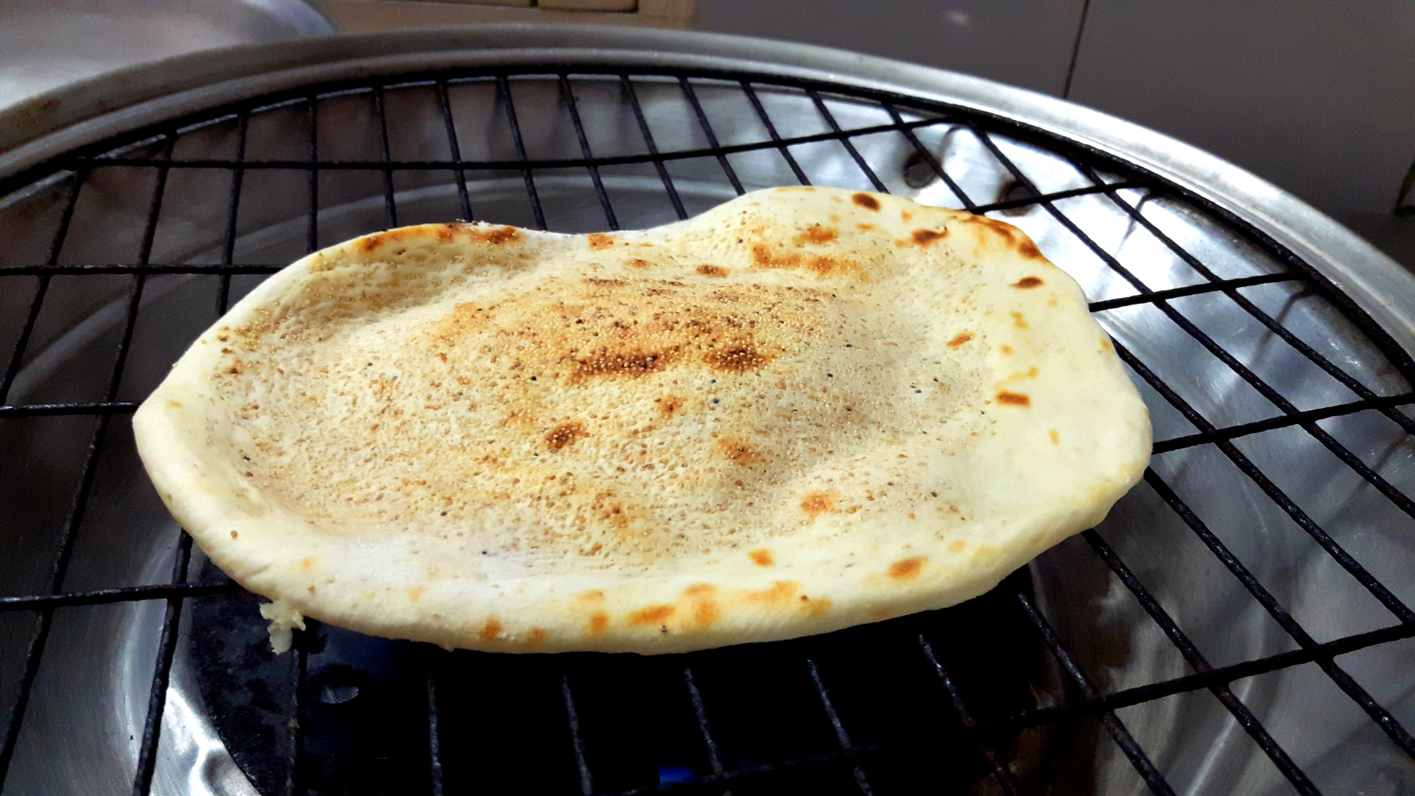put the Naan on wire mesh