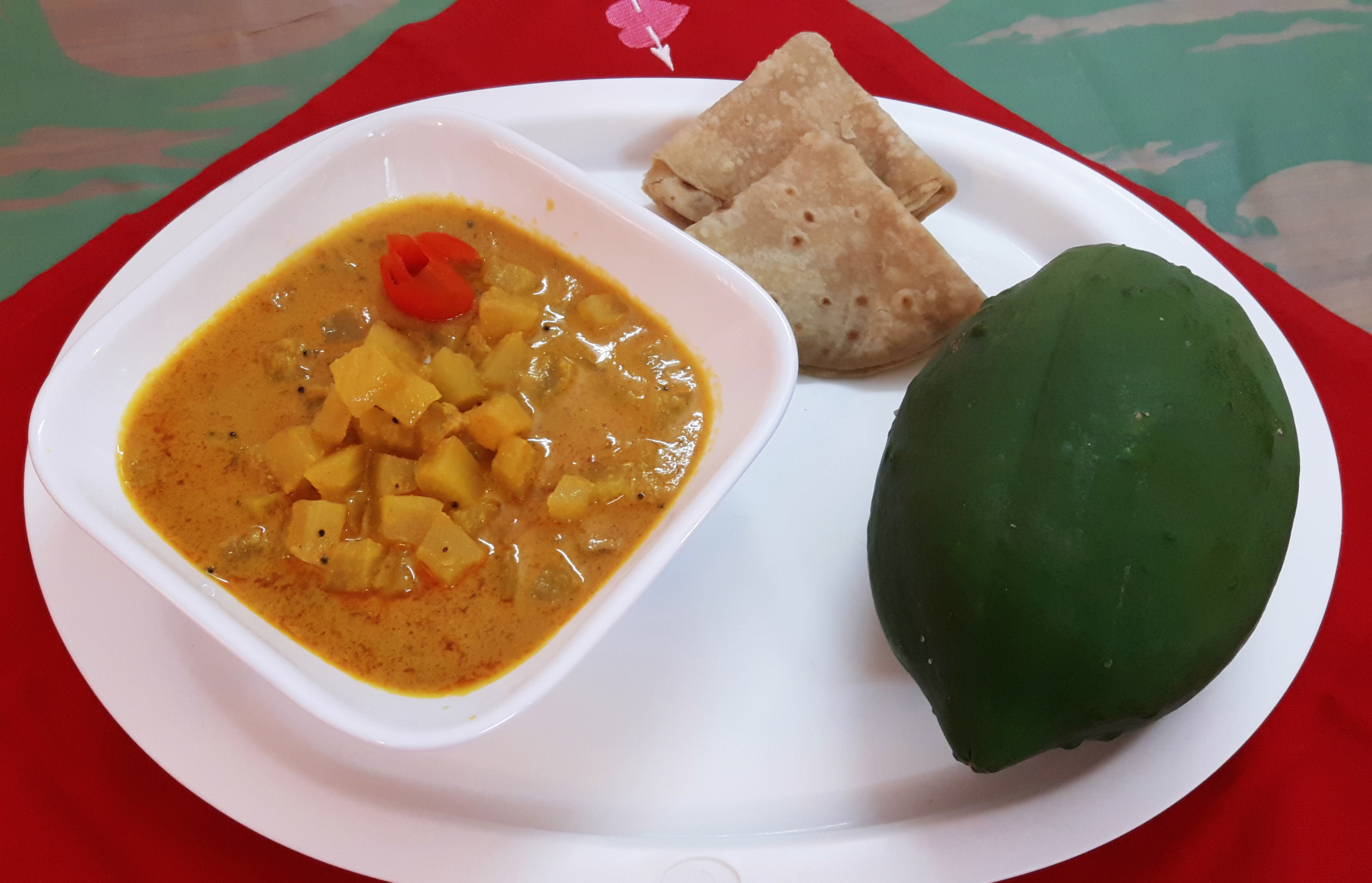 Kachche papita ki tarkari (Raw papaya curry with poppy seed)